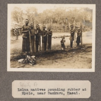 Lulua natives pounding rubber, at Mpolo, near Sankuru, Kasai