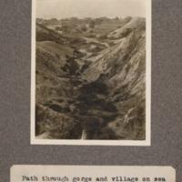 Path through gorge and village on sea shore, St. Paul de Loanda
