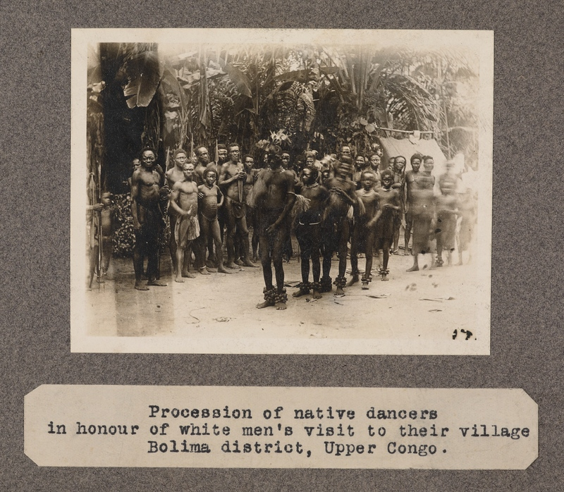 Procession of native dancers in honour of white men's visit to their village, Bolima Districts, upper Congo