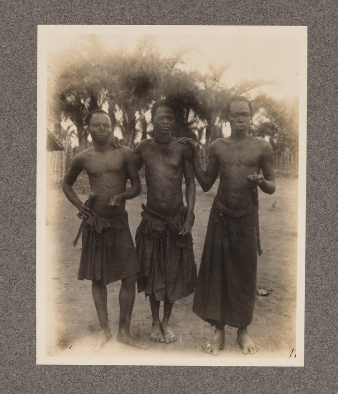 No caption [three native men]
